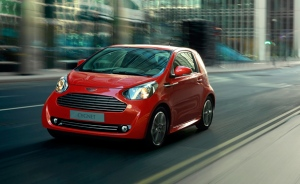Aston martin red cygnet moving in the streets