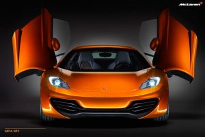 Orange Mclaren MP4-12C with doors open and headlight switched on