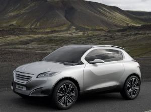 silver Peugeot HR1 concept going by side of the hills