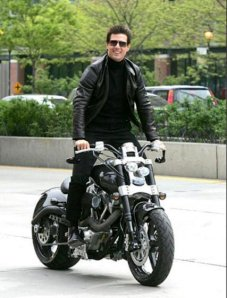 Tom cruise standing on his confederate hellcat