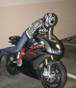 tom cruise on his black ducati 999R in his garage