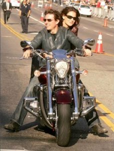 tom cruise with his girl friend on red honda rune