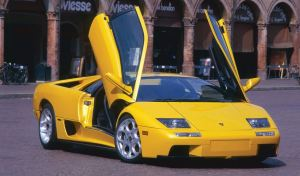 yellow color Lamborghini Diablo with scissor doors open